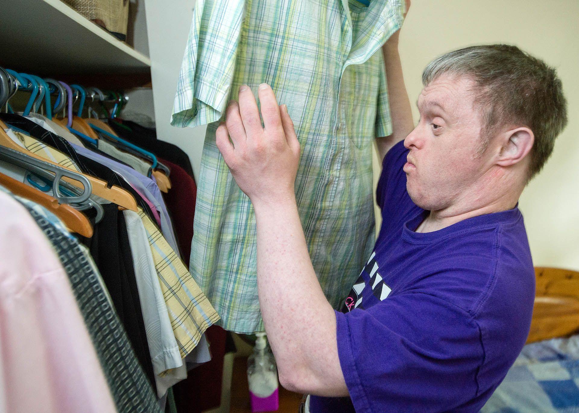 Man looking at his shirts