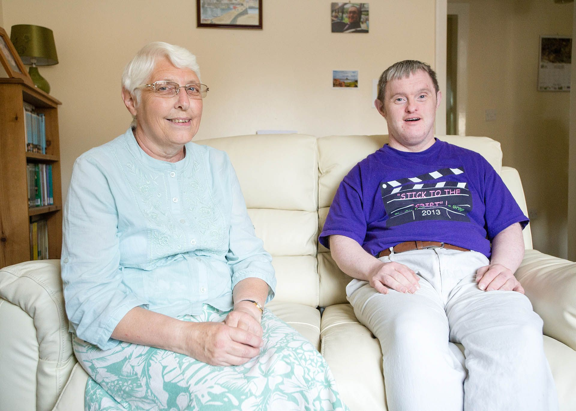 Man sat on a sofa with his mother