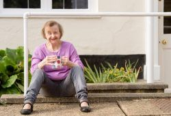 Woman with learning disabilities sitting outside