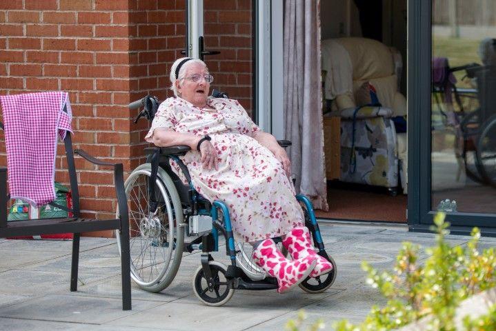 Woman sat in wheelchair