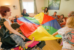 A group of people holding a parachute