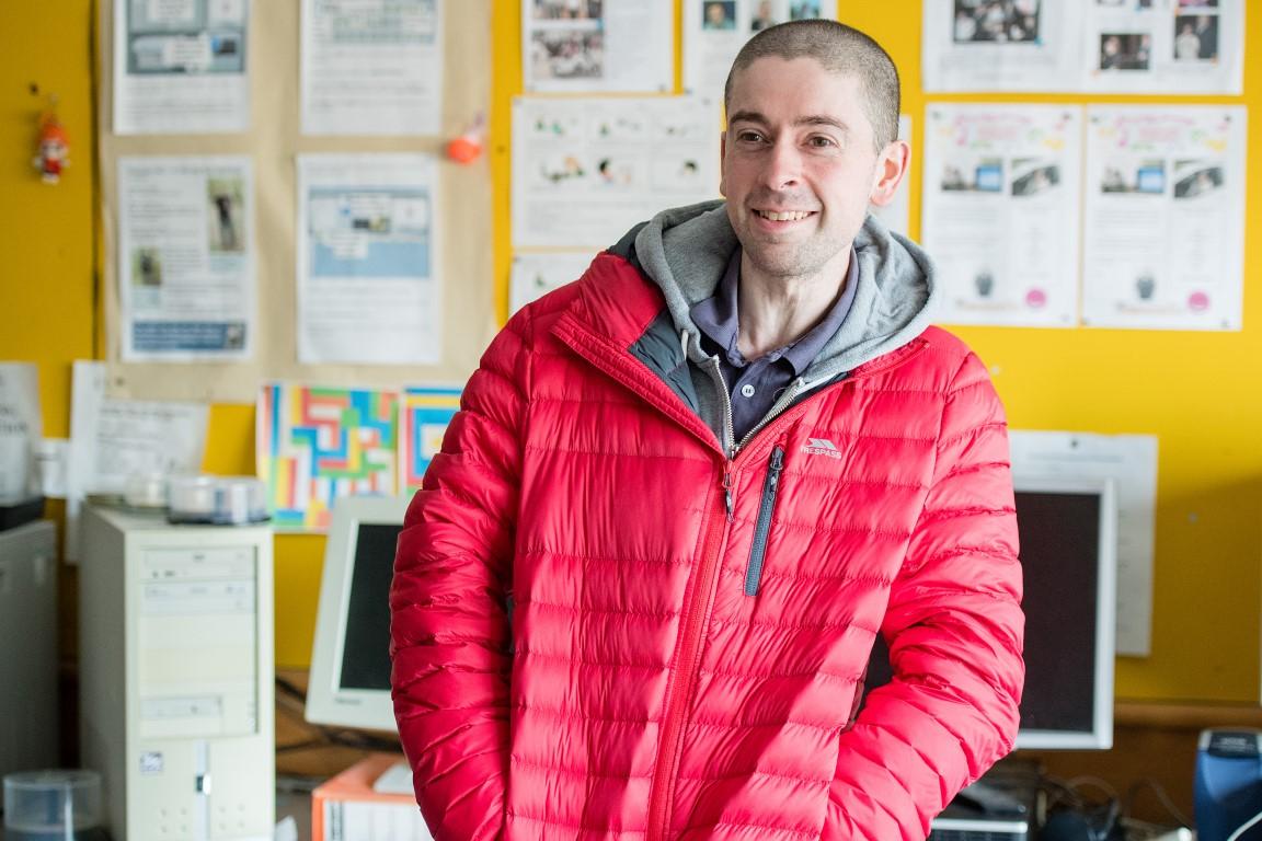 Man in red anorak smiling