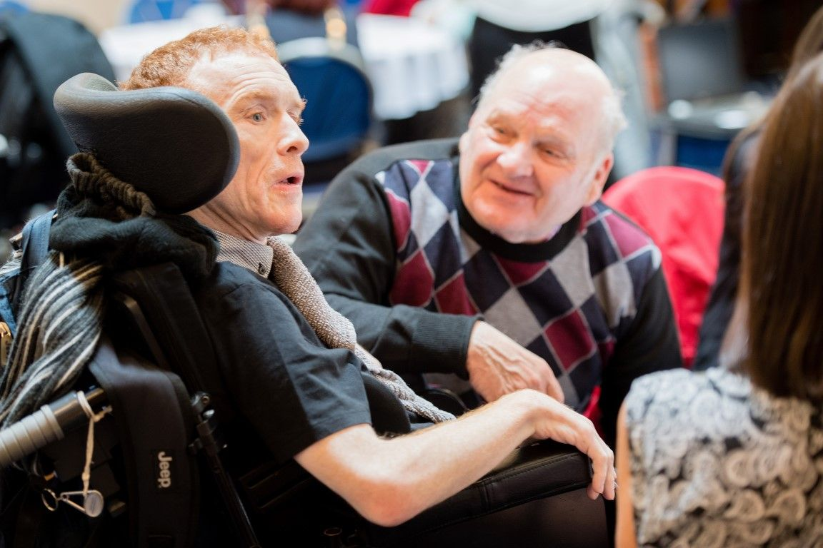 Man in wheelchair with his father