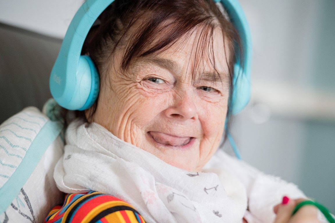 Woman with learning disabilities wearing headphones