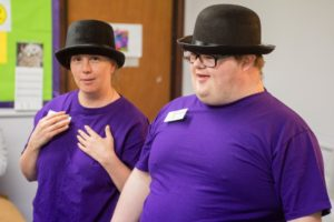 Woman and man with learning disabilities wearing bowler hats