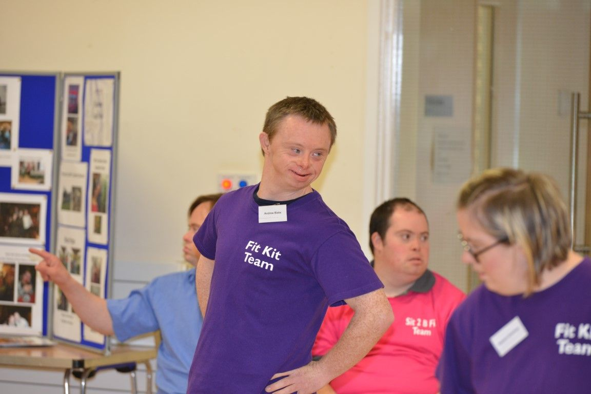 Man in purple T-shirt exercising