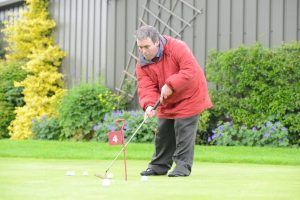 Man with learning disabilities playing golf