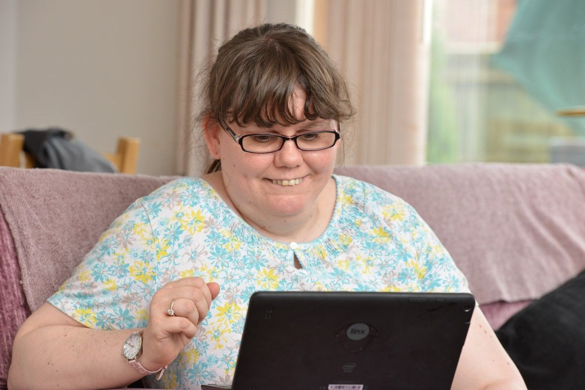 Woman with learning disability using small computer