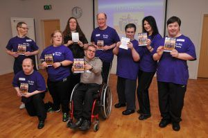 A group of people holding copies of the Fit Kit DVD