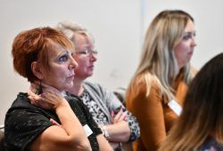 Women listening to a speech at charity conference