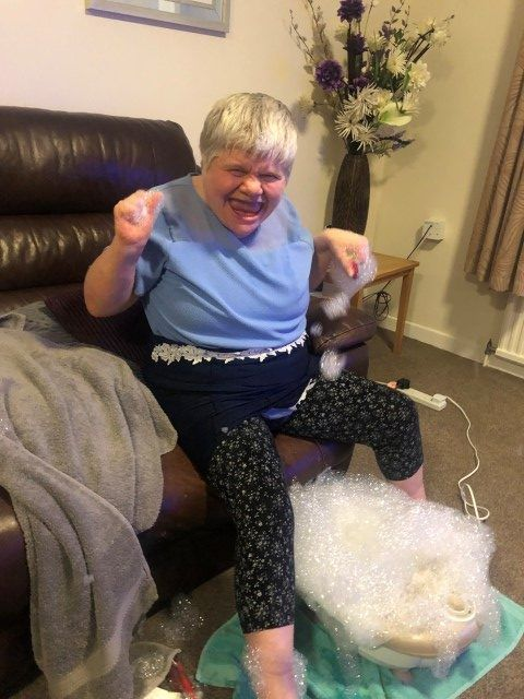 Woman enjoying a foot spa