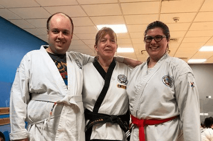 Man and two women at a Tang Soo Do lesson