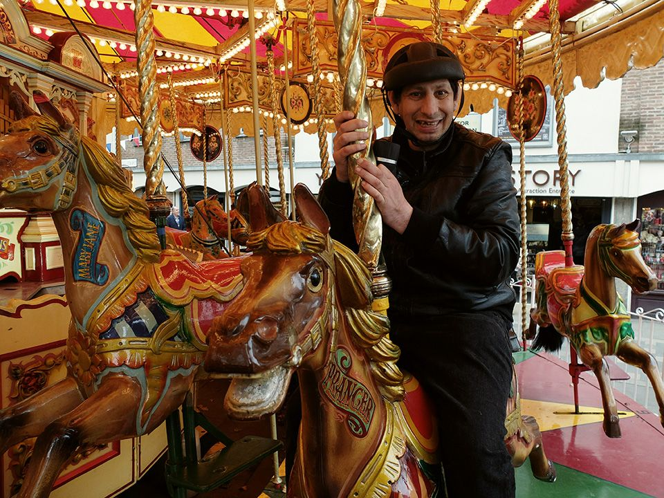 Man riding on a fairground carousel
