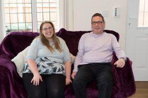 Woman and man on a purple sofa