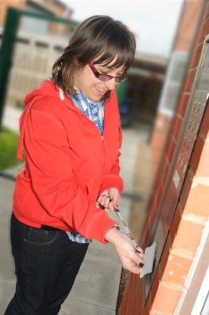 Woman with learning disabilities outside her front door