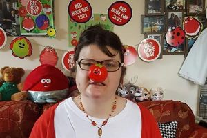 Woman wearing a red nose