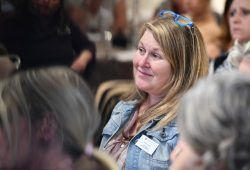 Woman listening to speech at charity conference