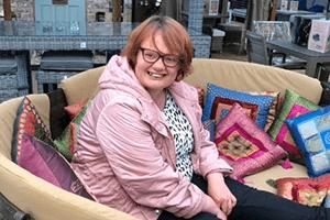 Woman sitting on sofa
