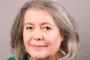 Woman in green top