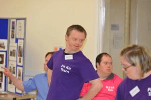 Man in purple shirt saying Fit Kit Team
