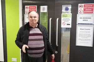 Man at a leisure centre about to go swimming