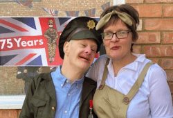 Man and woman at a VE Day party